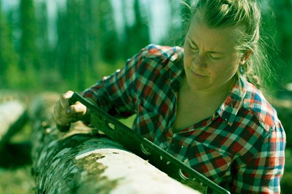 Image of Ashley Shelden as a log peelers