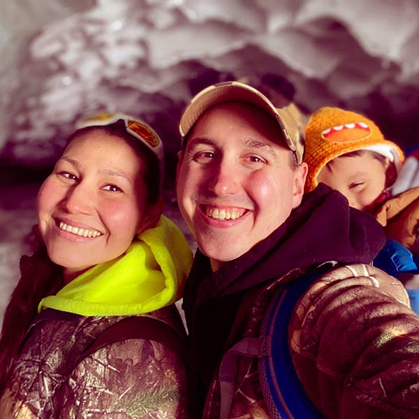Image of Scott with wife Krin along with their son At Castner Glacier Alaska.